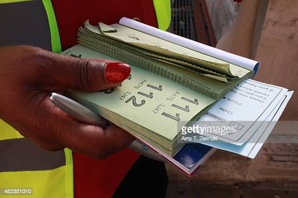 A worker distributes raffle tickets for The BBC Proms before the First Night of The Proms at Royal Albert Hall on July 18 2014 in London United...