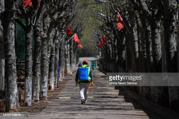 A worker does disinfection work at a school on March 12 2020 in Kunming Yunnan Province of China