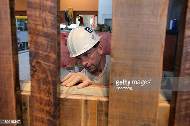 Worker does woodwork inside a new Whole Foods Market Inc. Store under construction in Park Ridge, Illinois, U.S., on Tuesday, Sept. 17, 2013. Whole...