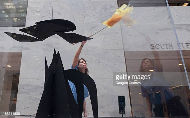 AOC worker Donna Blake gives the scale model of 'Mountains and Clouds' by Alexander Calder a good dusting in the Senate Hart Office Building The...