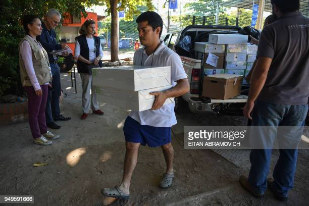 A worker downloads voting material at a polling station ahead of the upcoming April 22 presidential elections in Asuncion on April 21 2018 Opinion...