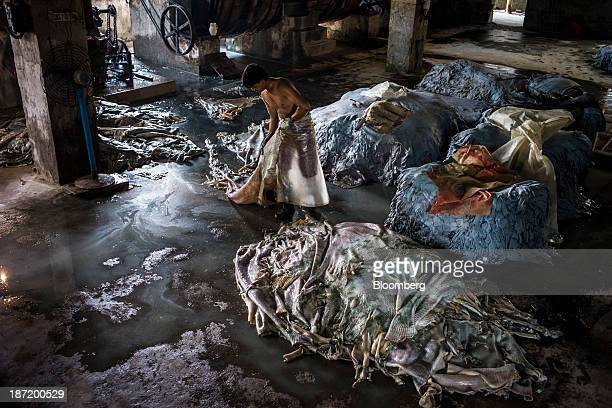 A worker drags a hide to a pile at a tannery in the Bantala area of Kolkata West Bengal India on Wednesday Oct 30 2013 India's industrial output...