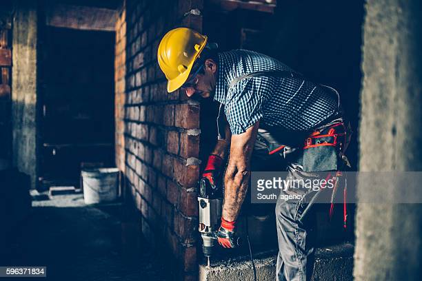 Worker drilling with a drill