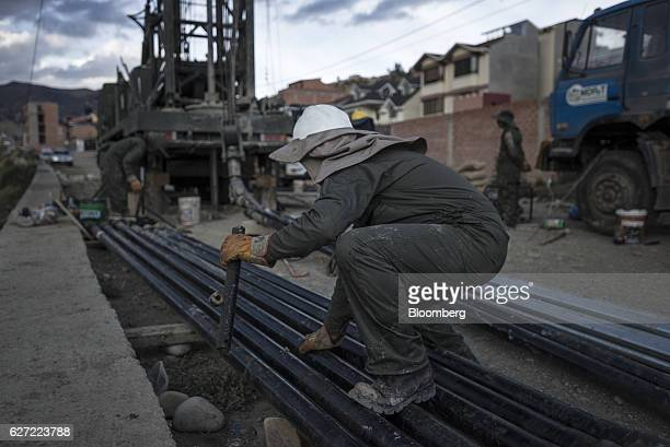 A worker drills a well in the Irpavi zone of La Paz Bolivia on Monday Nov 28 2016 Bolivia has declared a state of emergency as a severe water drought...