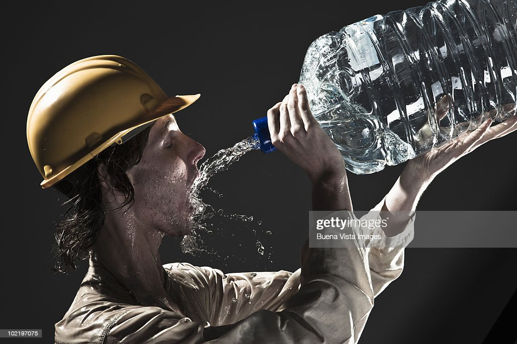 Worker drinking water : Stock Photo