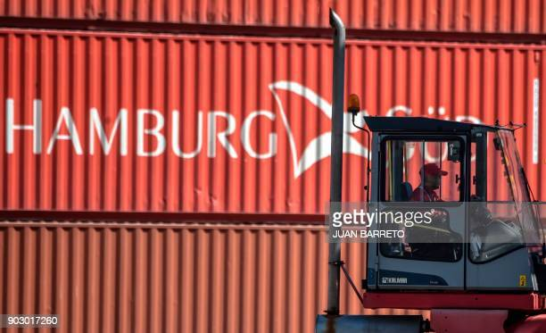 A worker drives a container handler at the main port of 'La Guaira' in Caracas on January 9 2018 / AFP PHOTO / JUAN BARRETO