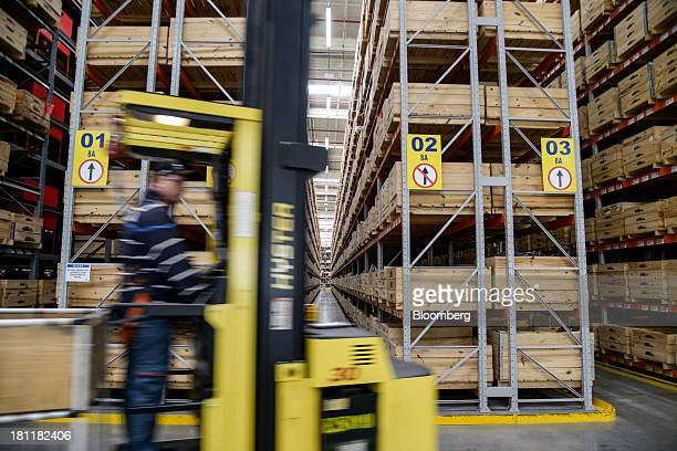 A worker drives a forklift at the Case New Holland assembly plant in Sorocaba Brazil on Wednesday Sept 18 2013 Higher crop production coupled with...