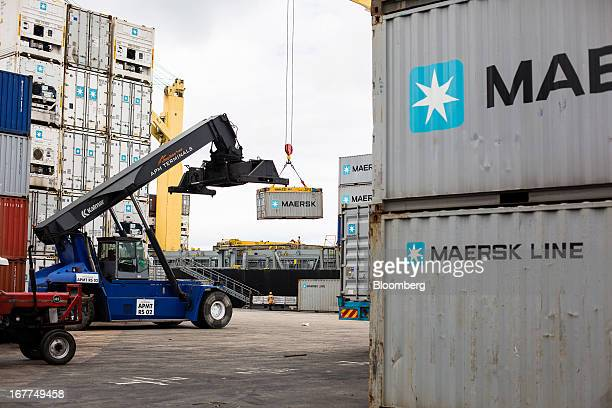 A worker drives a Kalmar reach stacker truck alongside AP MoellerMaersk A/S shipping containers on the dockside at Mombasa port managed by the Kenya...