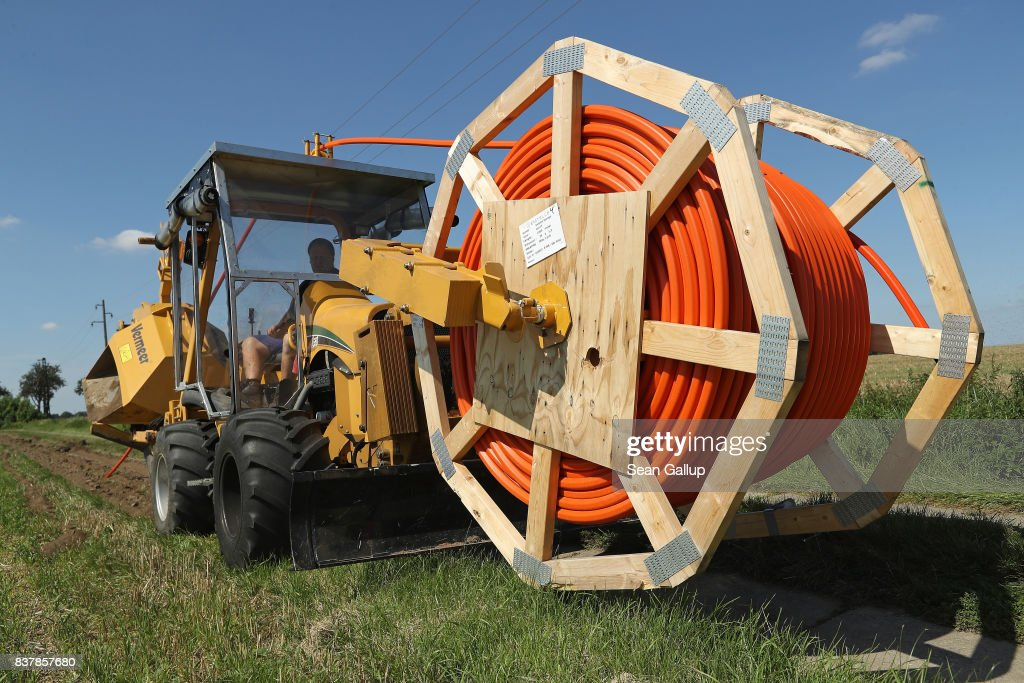 A worker drives a specialzed vehicle that is laying tubing used for running fiber optic cable underground during the installation of broadband infrastructure by a private company called MDDSL on August 23, 2017 near Haldensleben, Germany. The German government is subsidizing efforts to improve broadband access in rural areas. Germany faces elections on September 24 and rural development is a strongly political issue. Many rural areas in Germany, especially in the eastern parts, are facing challenges, especially due to demographics.