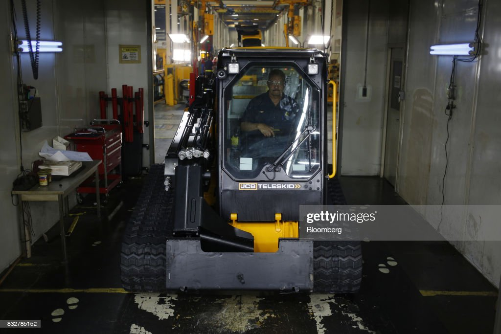 A worker drives a track loader construction vehicle through a testing booth at the JC Bamford Excavators LTD. (JCB) manufacturing plant in Pooler, Georgia, U.S., on Friday, Aug. 11, 2017. The Federal Reserve is scheduled to release industrial production figures on August 17. Photographer: Luke Sharrett/Bloomberg via Getty Images