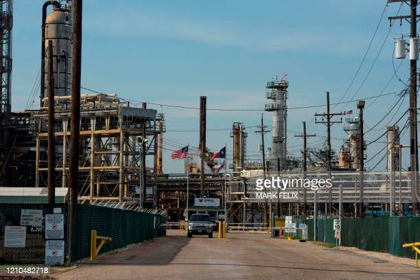 A worker drives out of the Valero Houston Refinery in Houston Texas on April 20 2020 US oil prices crashed to unprecedented lows on April 20 as...