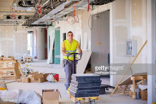 worker driving a pallet truck - serbia stock pictures, royalty-free photos & images