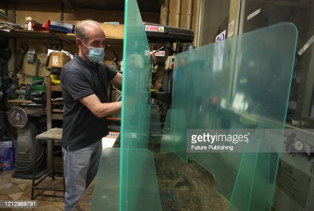 Worker, during the processing of plexiglass protection panels, a few days after the end of the lookdown to prevent the spread of the coronavirus,...