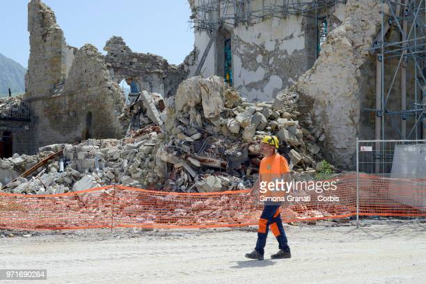 Worker during the visit of The Italian premier Giuseppe Conte in the areas of the earthquake of August 24 on June 11, 2018 in Amatrice, Italy.