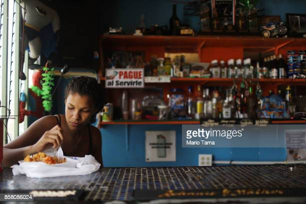 A worker eats lunch in a bar without power about two weeks after Hurricane Maria swept through the island on October 5 2017 in San Isidro Puerto Rico...
