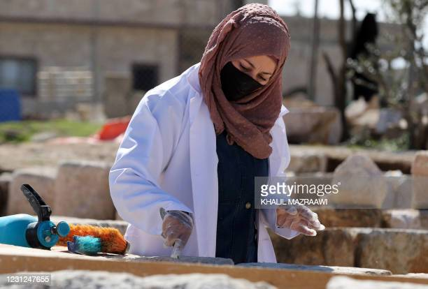 Worker employed by a pilot project run by the UN cultural agency UNESCO, restores a stone wall at an ancient church complex, in the small town of...