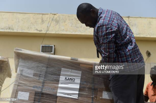 A worker examines electoral materials on a trailer at the headquarters of Independent National Electoral Commission in Kano on February 14 2019...