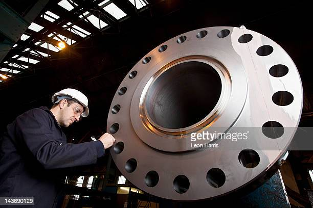 worker examining metal in steel forge - sheffield stock pictures, royalty-free photos & images