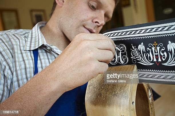 Worker examining weaving in shop