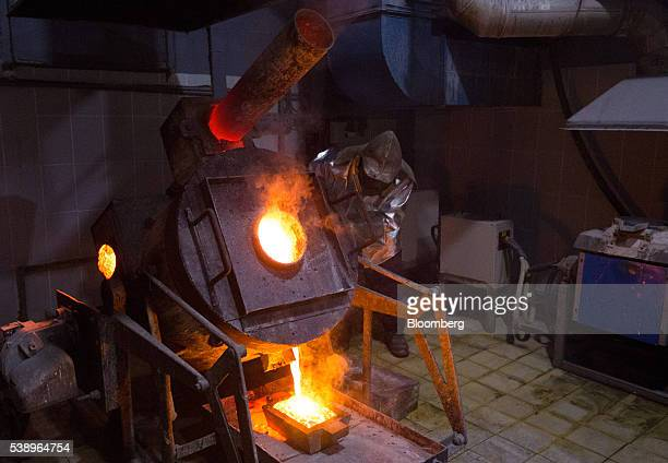 A worker fills a casting mold with molten gold at the Suzdal gold mine operated by Nordgold NV in Semey Kazakhstan on Tuesday June 7 2016 Nordgold...