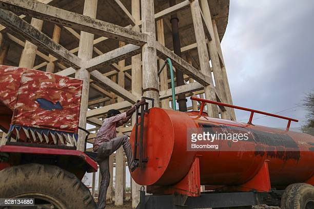 Worker fills a water tanker at the Vivekananda Chowk water tank in Latur, Maharashtra, India, on Saturday, April 16, 2016. Hundreds of millions of...