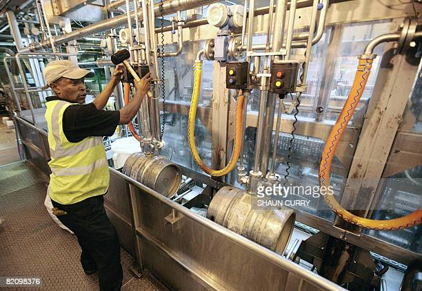 A worker fills barrels with beer on July 29 2008 at the Fullers brewery in London A pint of beer may be an official 'Icon of England' but sales have...