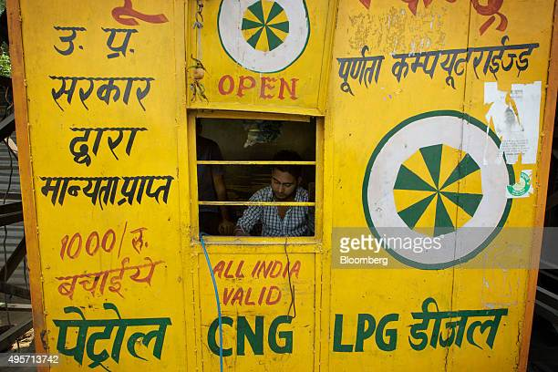 A worker fills out a document at a roadside vehicle emission testing kiosk in Delhi India on Thursday Oct 29 2015 India in October was the last major...