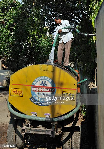 A worker fills up a government water supply tanker in Hyderabad on March 22 on World Water Day World Water Day calls for international attention on...