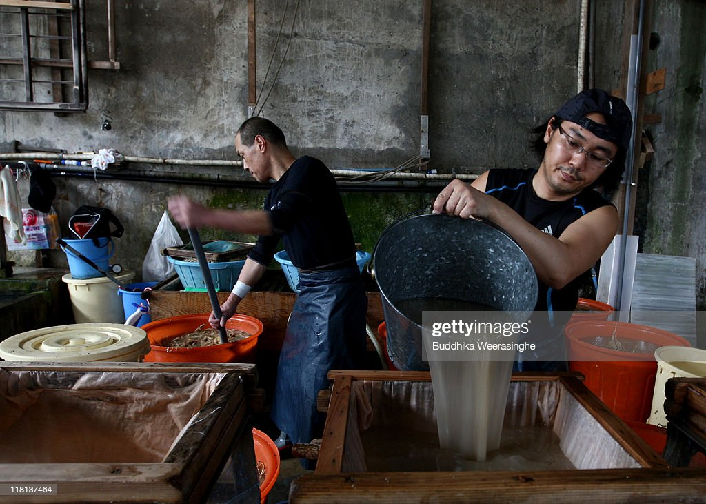 A worker filters pulp at a mill that produces handmade paper at Iwano Heizaburo Seishi Sho Company in Echizen village on July 4, 2011 in Fukui, Japan. Washi paper is a tough paper, used for traditional Japanese arts such as Origami and Shodo, most commonly made from bark of the mulberry, gampi or mitsumata. The paper milling process is a traditional craft of the Echizen people dating back 1500 years which continues today along with modern paper manufacturing. Echizen city is home to many paper businesses, as well as the cultural museum of paper and papyrus centre where visitors can make their own paper.