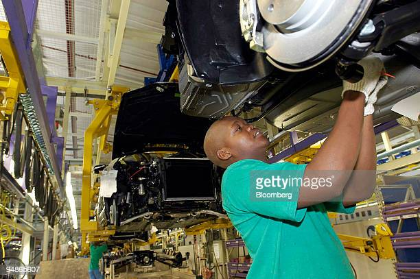 A worker fits car parts at a BMW factory in Rosslyn Pretoria South Africa Tuesday March 9 2004 President Thabo Mbeki whose African National Congress...
