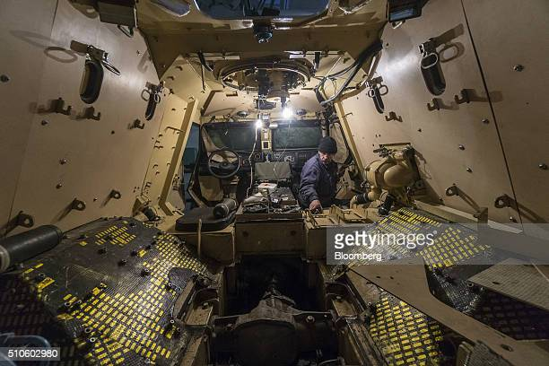 A worker fits out the interior of a DozorB armored car on the assembly line in the military workshop operated by Ukroboronprom in Lviv Ukraine on...