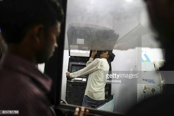 A worker fixes an automated teller machine inside a State Bank of India branch in Mumbai India on Friday Nov 18 2016 India's top court refused to...