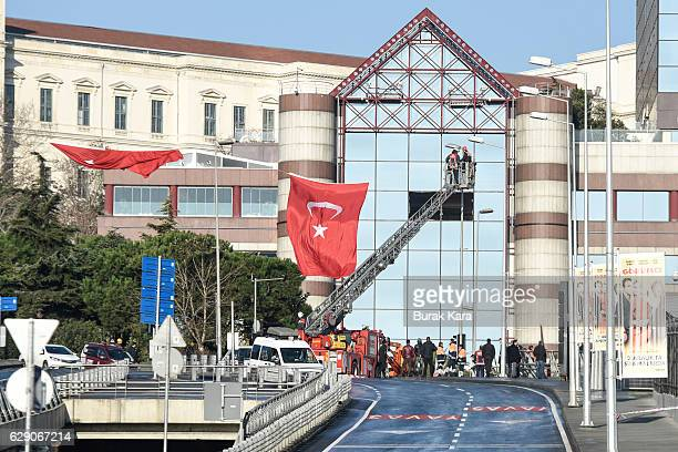 Worker fixes the broken windows in front of the blast scene the day after an explosion at the Vodafone Arena Stadium on December 11, 2016 in...