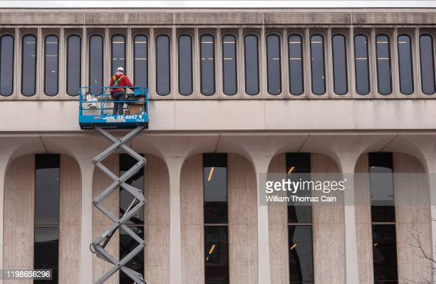 Worker fixes windows on a building on campus at Princeton University on February 4, 2020 in Princeton, New Jersey. The university said over 100...