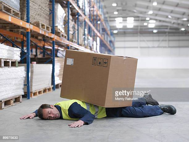 Worker Flattened By Box In Warehouse