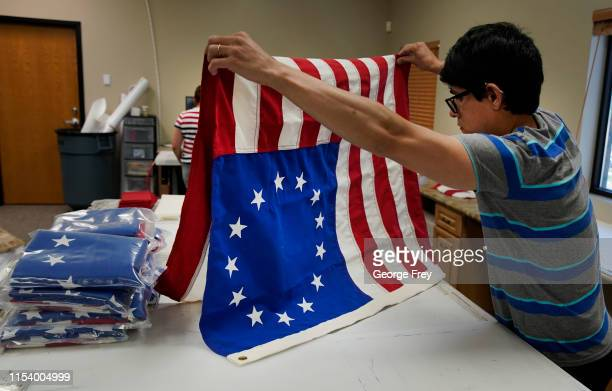 Worker folds a newly made Betsy Ross flag made out of fire proof material at Colonial Flag on July 5, 2019 in Salt Lake City, Utah. The Betsy Ross...