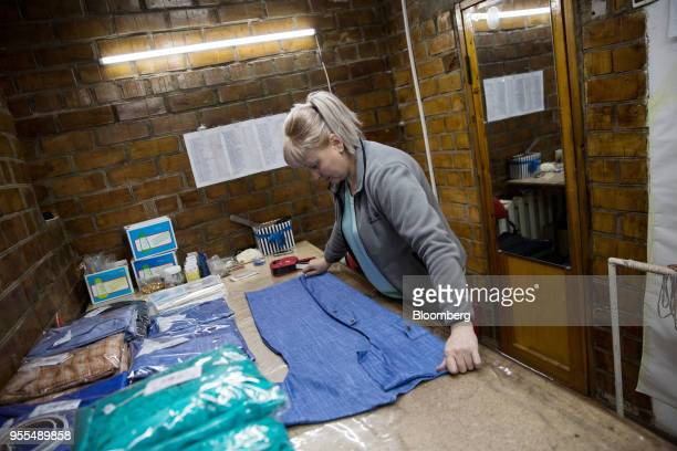 Worker folds a shirt at a Guka Jalie Ladieswear garment factory in Bishkek, Kyrgyzstan, on Wednesday, April 18, 2018. The Kyrgyz Republic ranked 77th...