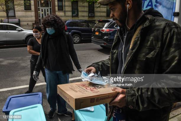 Worker for Black Women's Blueprint hands out free masks on May 5, 2020 in the Crown Heights neighborhood in the Brooklyn borough in New York City....