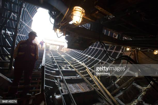A worker for Mosmetrostroy OJSC descends an access stairway to the underground rail tunnels at the Sheremetyevskaya metro station in Moscow Russia on...