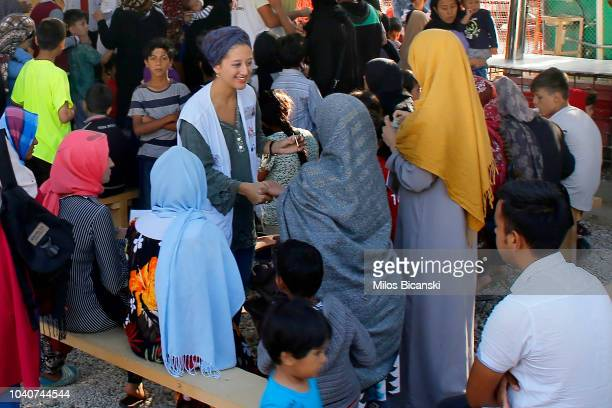 A worker from Doctors Without Borders talk to refugees inside their mobile clinic for children outside of Moria Reception centre at Moria Refugee...