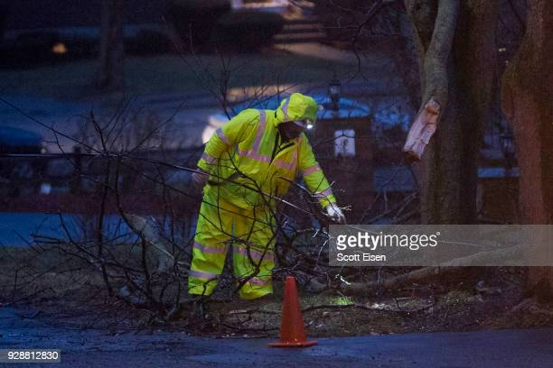 A worker from National Grid checks on a downed highpower line on Landgrane St on March 7 2018 in Quincy Massachusetts Large portions of the East...