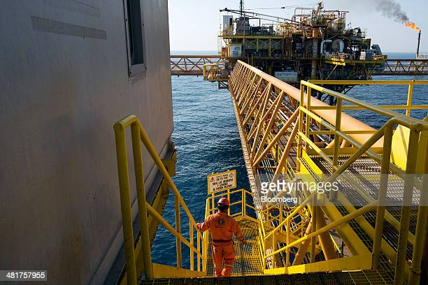 A worker from Oceanografia SA walks down a set of stairs on a section of the Petroleos Mexicanos PolA Platform complex located on the continental...