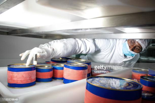 A worker from the company Rova Caviar Madagascar verifies with a little hammer the metal boxes packed with the caviar extracted from a sturgeon at...