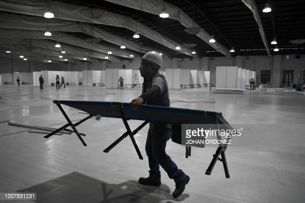 A worker from the Guatemalan Health Ministry helps mount a temporary hospital to treat possible cases of the novel coronavirus COVID19 at Park of the...