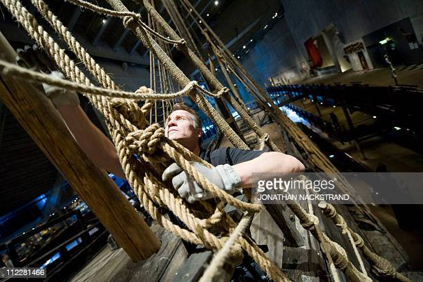 Worker from the Vasa Museum inspect a rope on the deck of the ship as it is displayed in Stockholm,on April 8, 2011. Sweden's 17th century royal...