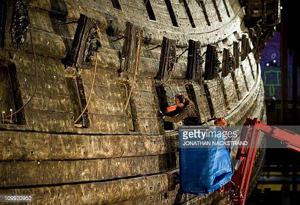 Worker from the Vasa Museum replaces an iron bolt, originally installed in the 1960's, with a special bolt in highly advanced stainless steels from...