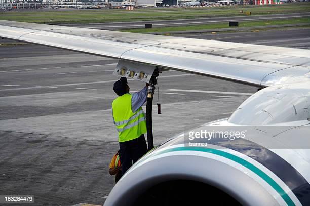 worker fueling jet