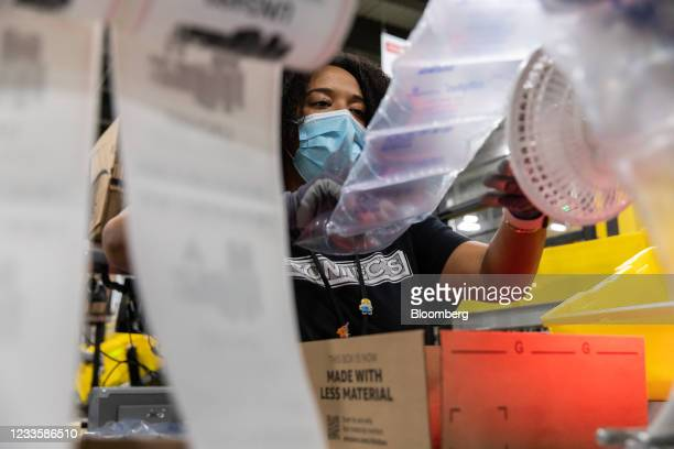 Worker fulfills orders at an Amazon fulfillment center on Prime Day in Raleigh, North Carolina, U.S., on Monday, June 21, 2021. Amazon.com Inc.'s...