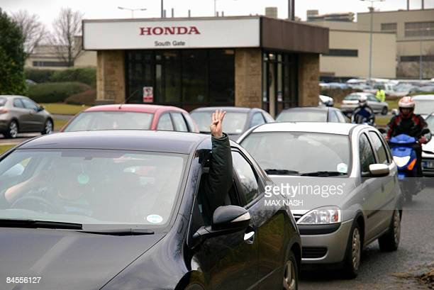 A worker gestures as he leaves the Honda car factory in Swindon southwest England on January 30 2009 Workers at Honda's British factory made the last...