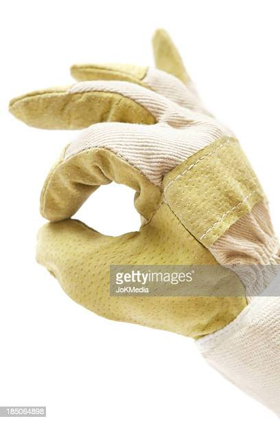 worker giving ok sign - work glove stock photos and pictures
